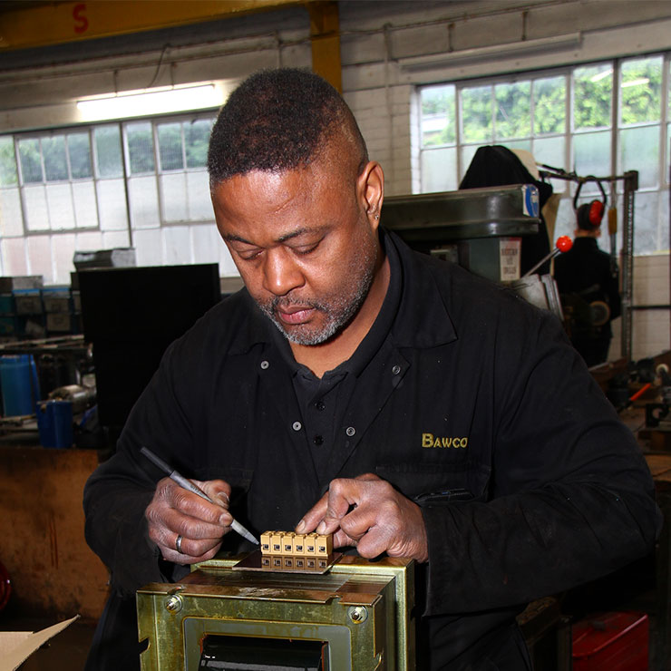 Peter from Bradford Armature Winding Company is working on a Transformer.
